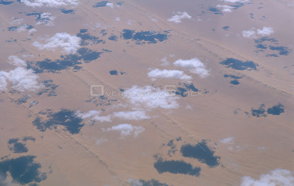 Aerial view of clouds over desert with shadows on land Somalia