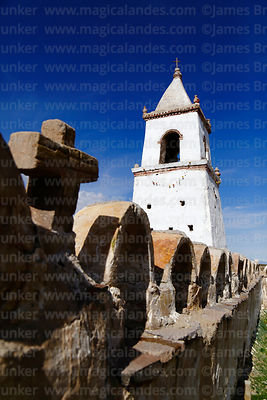 Stone cross on surrounding wall and belfry of Santo Tomás church, Isluga village, Isluga National Park, Region I, Chile