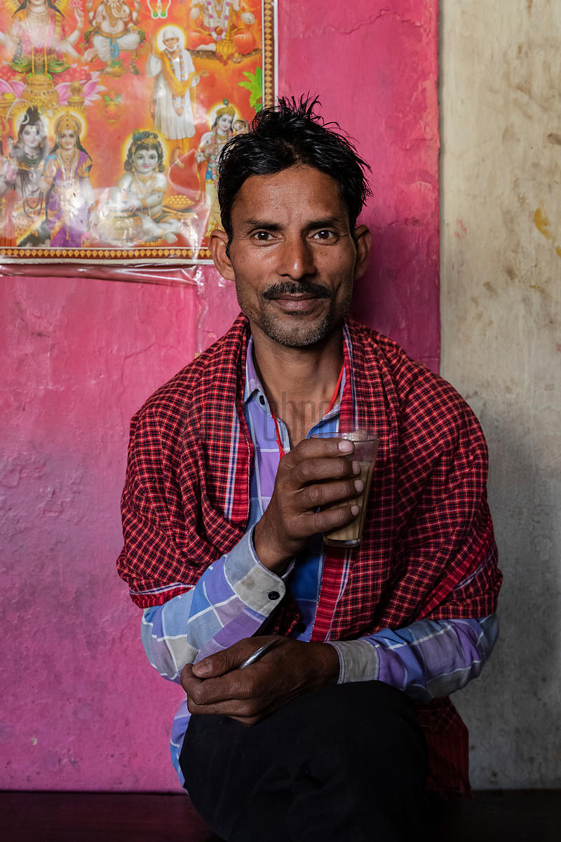 Portrait of a Spice Porter at the Chandni Chowk Spicemarket Drinking a Cup of Tea