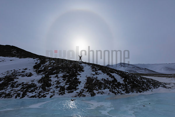 John Lyon Jumping in Front of a Sunbow