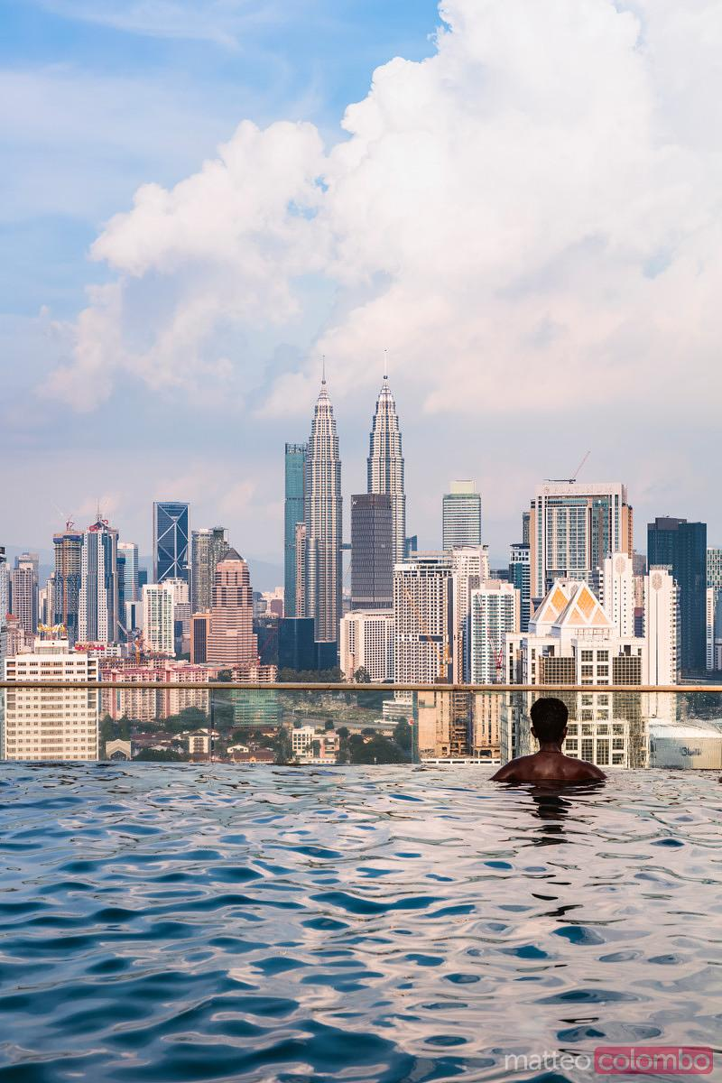 Matteo Colombo Travel Photography  Man in an infinity pool with