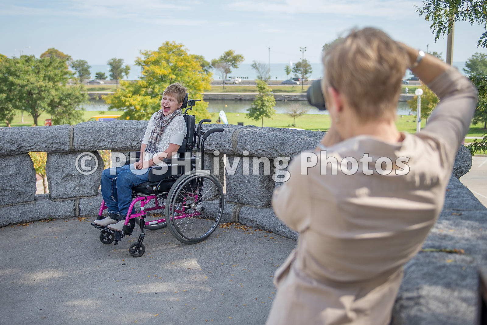 Mother Wheeling Her Daughter At Park