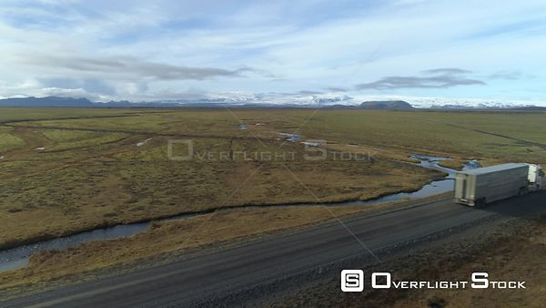 Cargo Livestock Truck on Dirt Road Under Vatnajokull Glacier Iceland, Aerial