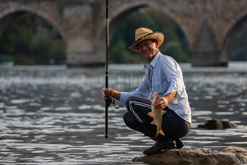 Fisherman Displays his Catch from the Drina River