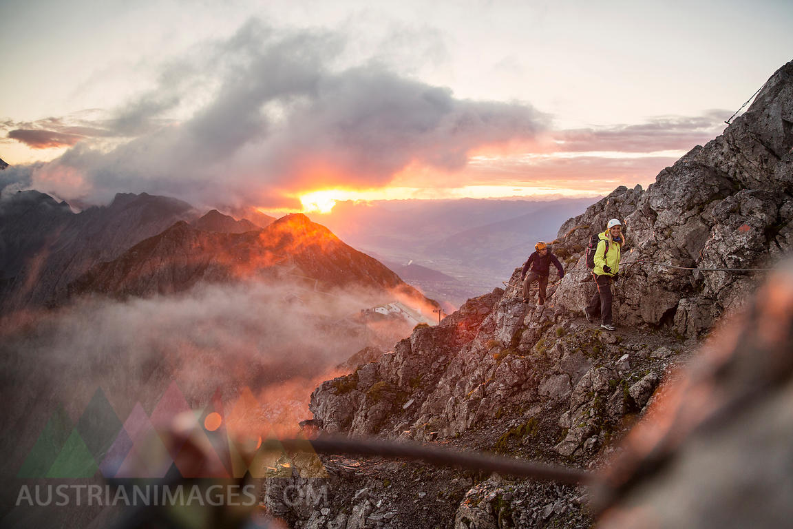Austria, Tyrol, Innsbruck, mountaineer at Nordkette via ferrata at sunrise