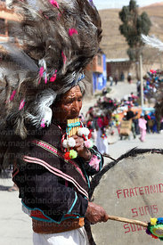 Indigenous suri sikuris musician playing sicus and bombo drum at Chutillos festival , Potosi , Bolivia
