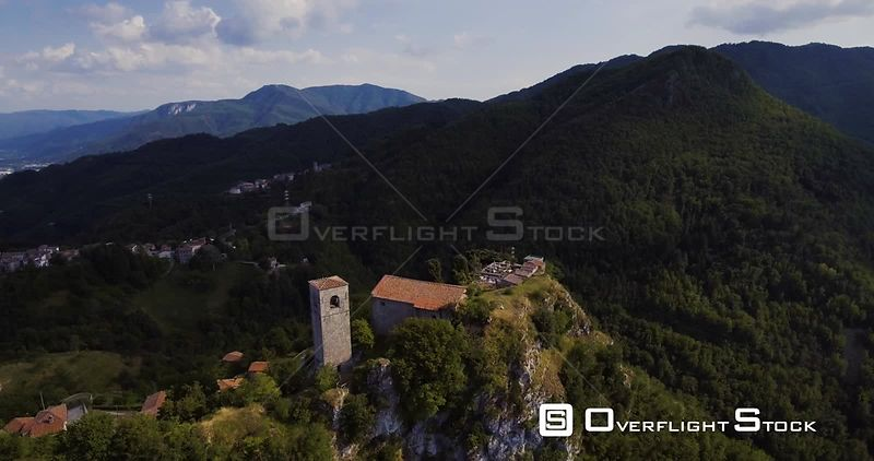 Aerial, medieval tower Rocca Di Sassi on top of the Apuan Alps in Tuscany, Italy