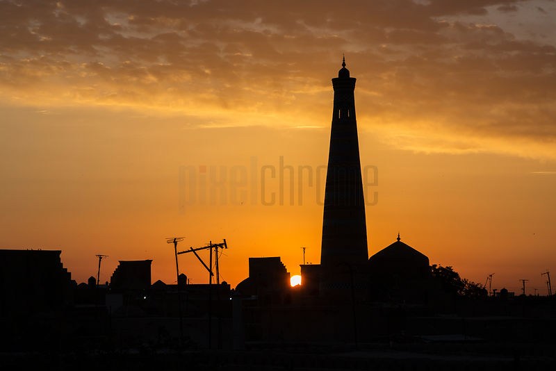 Silhouette of the Islam Khodja Minaret at Sunrise