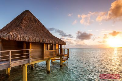 Overwater bungalow at sunset, Rangiroa, French Polynesia