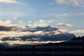 Clouds drift around Mt Illimani soon after sunrise, Cordillera Real, Bolivia