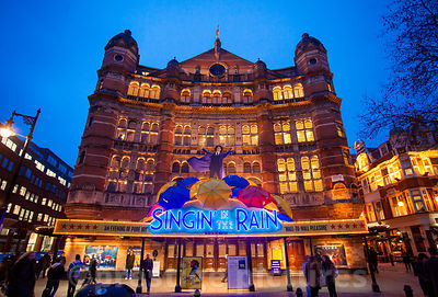 Night Time Exterior of the Palace Theatre in  London with SInging in the Rain running in 2013