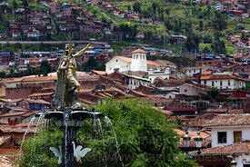Statue of the Inca Pachacuti Inca Yupanqui or Pachacutec on fountain, Santa Ana church in background, Plaza de Armas, Cusco, ...