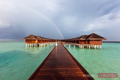 Rainbow over bungalows on an island of the Maldives