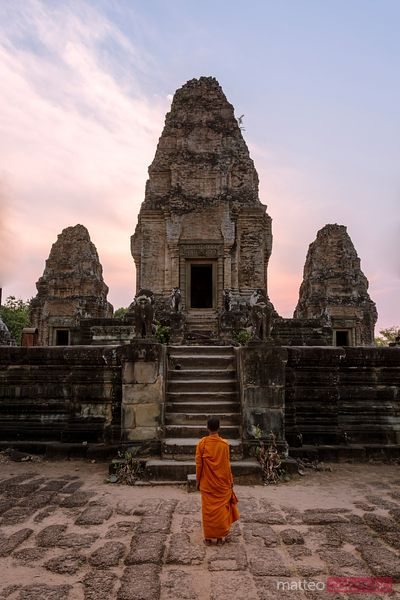 Cambodia, Siem Reap, Angkor Wat complex. Monks inside East Mebon temple, at sunset (MR)