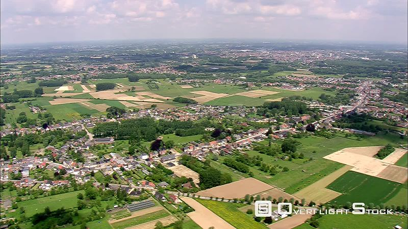 Flying over rural land and villages near Brussels, Belgium