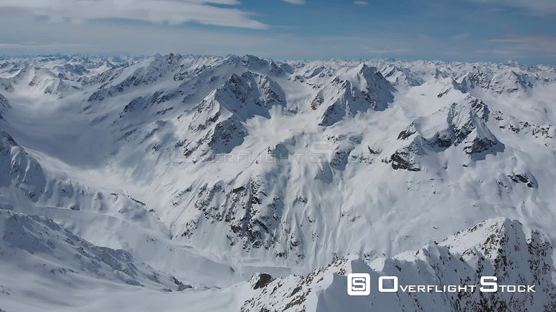 Aerial shot of snowcaped peaks and glaciers of Alps in Tyrol, Austria