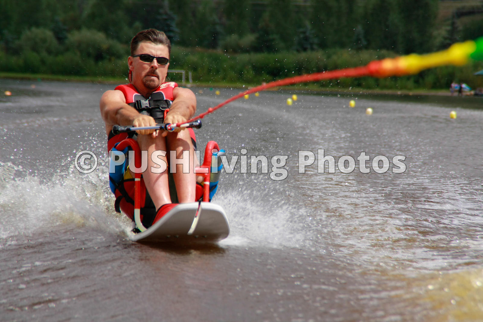 Man on a water sit ski in competition