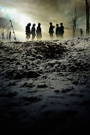 An atmospheric image of silhouetted British and German soldiers meeting for the christmas truce of 1914 in no man's land in WW1.