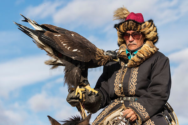 Kazakh Golden Eagle Hunter on his Horse
