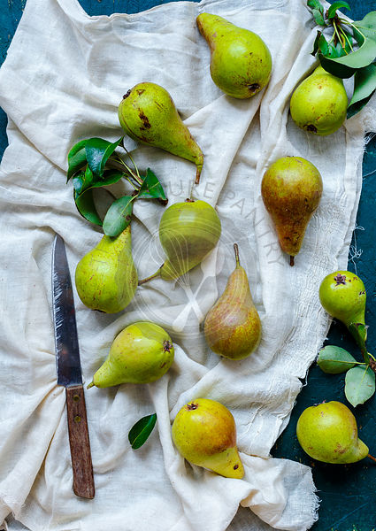Pears on a white fabric - Top Down View