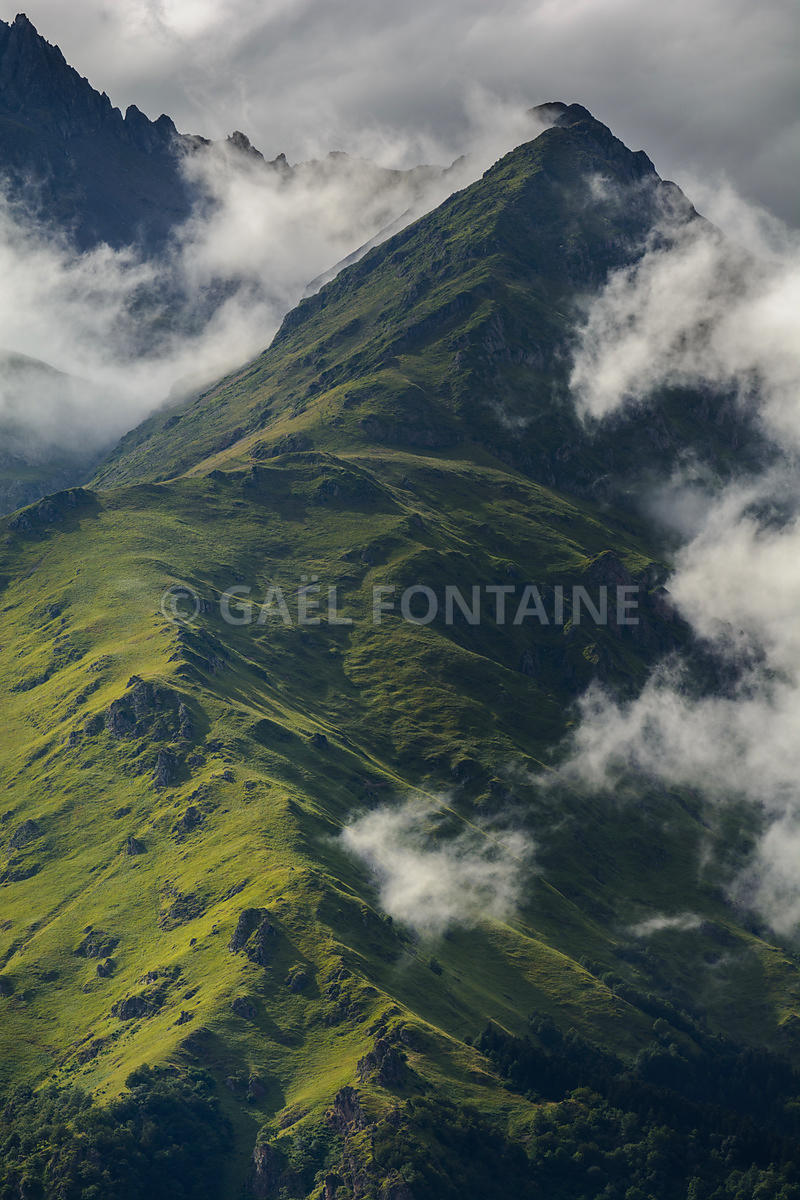 Peak of Pyrenean mountains with a cloudy atmosphere, France
