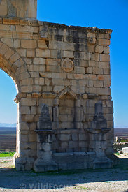 The Triumphal Arch over the Decumanus built 217 AD, rebuilt 1930 AD, corrected 1960 AD, Volubilis, Morocco; Vertical