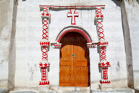 Detail of entrance facade of rustic church in Cotasaya village, Region I, Chile