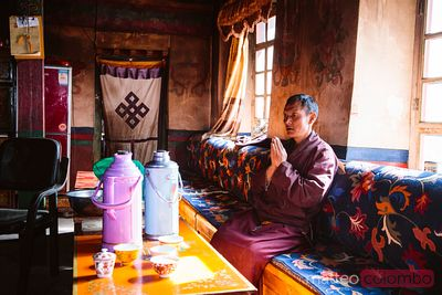 Monk inside monastery kitchen, Tibet