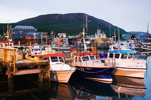 The fishing harbour at Husavik at midnight, Iceland