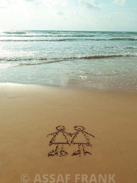Friends drawn in sand on the beach