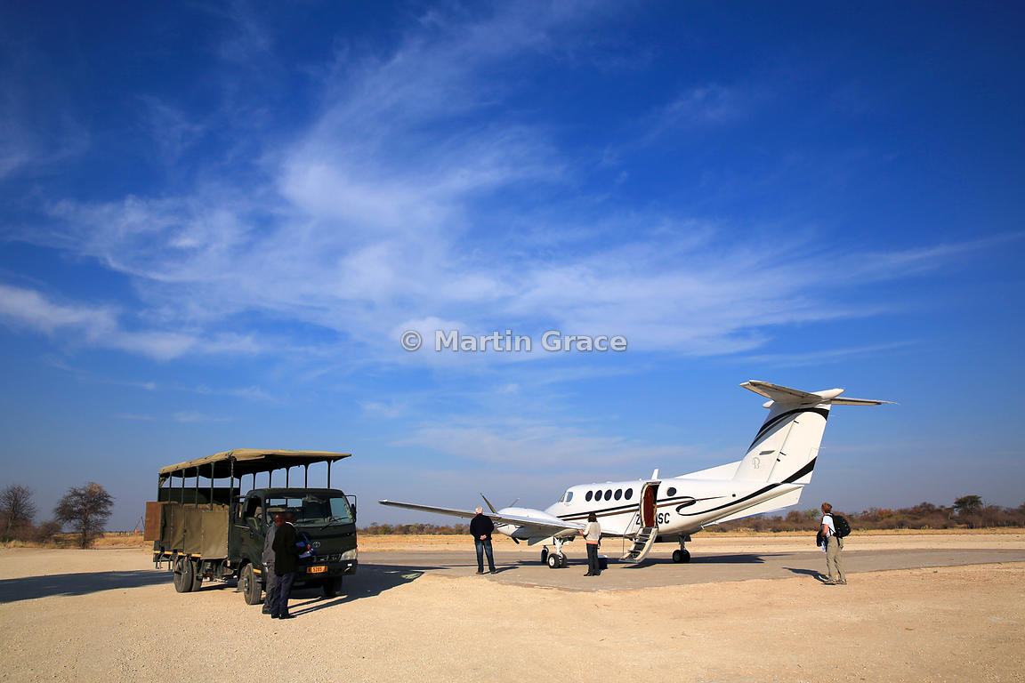 Beechcraft King Air on the apron at Mokuti Safari Lodge, Etosha, Namibia, with Lodge transport