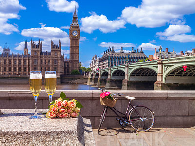 Champagne glasses with bunch of flowers against big ben and Westminster bridge, London, UK