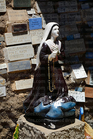 Statue of Virgen de Lourdes and thank you messages from devotees in grotto, Arica, Region XV, Chile