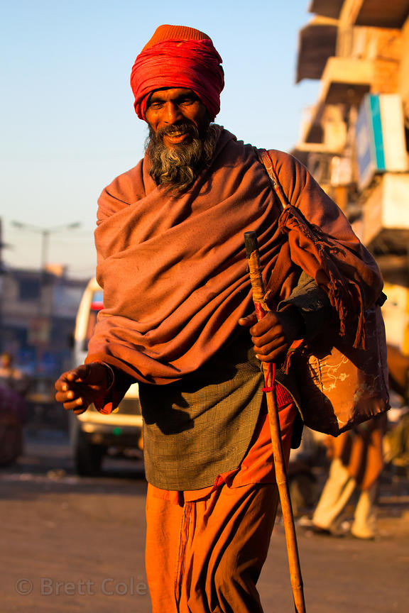 Sadhu (holy man) walking at sunrise, Jodhpur, Rajasthan, India