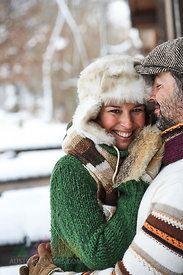Portrait of happy couple wearing winter fashion