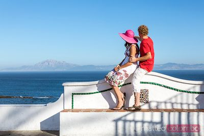 Adult couple looking at the Strait of Gibraltar, Tarifa, Spain