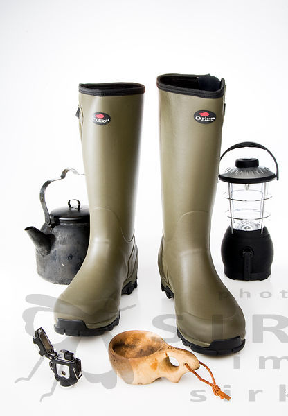 Rubber boots with Hiking equipment
