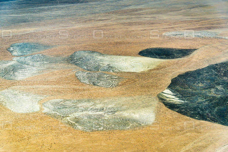 Coloful Pattern of Volcanic Deposits Form Abstract Shapes on a Nevada Desert Floor.