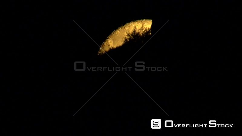 Aerial shot of people on a mountain silhouetted against a bright Super Moon. Western Cape South Africa