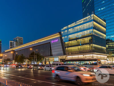 Retail architecture photographer - Exterior facade view at dusk of Shin Kong Place mall (SKP Beijing) designed by Syberite  i...