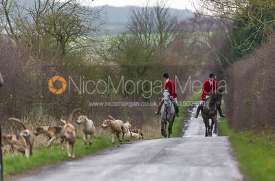 Huntsman and hounds coming up a road near Pickworth