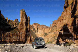 Toyota Land Cruiser and rock formations in Palca Canyon, La Paz Department, Bolivia