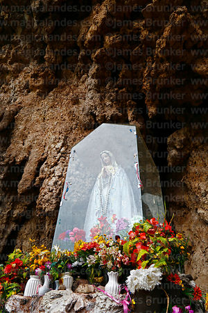 Shrine to Virgen de Fatima and limestone rock overhang, Lamay, Sacred Valley, Cusco Region, Peru
