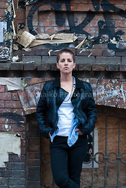 young beautiful woman with short hair posing on old wall background - urban around - Berlin street style