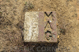 MAG sign on the ground at the Plain of Jars indicating that unexploded bombs have been cleared in Phonsavan, Xiangkhouang, Laos