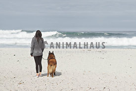 dog and woman at the beach