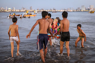 A family immerses their Ganesh Idol in the Arabian Sea during the Ganesh Chaturthi Festival, Mumbai, India.
