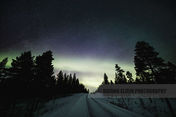Aurora band above the road in Inari