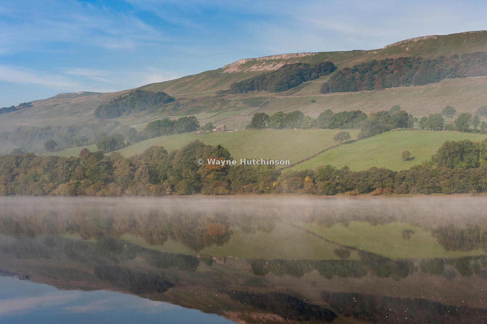 Autumn mist and reflections on Semerwater in the Yorkshire Dales National Park, UK.