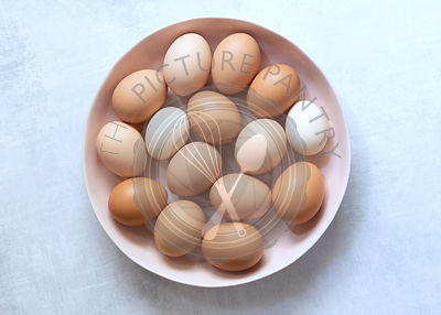 Brown and white eggs in a bowl.